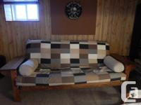 Lovely oak frame futon with collapsible side tables on