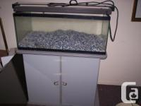 FOR SALE:. 45 gallon fish tank with stand, comes with 2