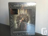 The complete season 1 of Game of Thrones, still sealed