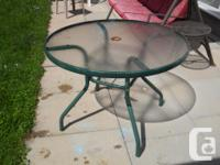 "Green Glass Top Patio Table, 28"" H x 39"" Dia. $30.00"