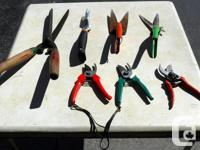 For sale are some hand clippers, garden tools, a pick