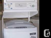A matching GE compact portable washer dryer set in