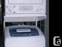 A matching GE compact portable washer dryer set in like