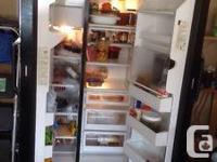 GE double door fridge with ice machine in good