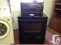 Black GE electric cooking range with self cleaning