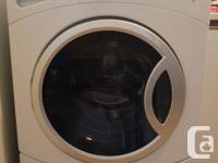 Up for sale are a matching pair of front-load washer