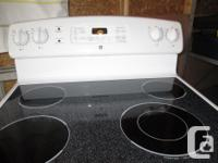 "30"" GE flat-top stove with steam-self-cleaning"