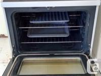 White GE smooth top self cleaning stove for sale, $75.