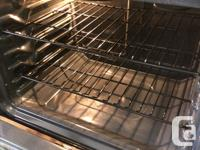 This is a stainless steel stove by GE. It looks and