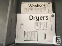 GE Stainless Steel Washer and Dryer on pedestals with