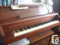 1.  An apartment-size upright piano made by Gerhard
