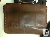 Genuine leather brief case,or can be used as a lab top