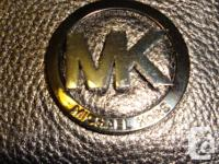 ONE HUNDRED % Genuine. Button flap closure. Silver 'MK'