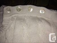Authentic ladies's Burberry polo sweater purchased from
