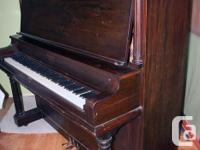 This 1938 vintage Gerhard upright grand piano features