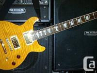 2002 Gibson LP DC with AAAAA Amber top...$1250.00  1995