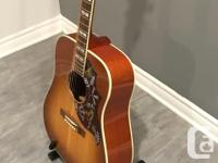 Sitka Spruce top. Mahogany back and sides. In Excellent