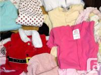For sale are a bunch of girls baby clothes as shown in