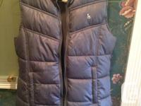 Grey puffy vest girls size Large for sale. Worn three