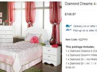 A 4-piece bedroom set for sale. ~ Headboard, night