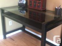 Dark wood and glass desk with a rollout tray. The tray