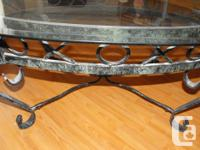 Oval shaped, glass coffee table. Glass top and metal