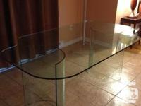 Selling a glass dining room table. Bought it 8 years