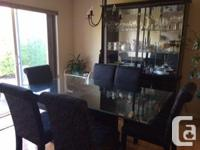 Beautiful glass dining room table with 6 black cloth
