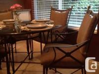 "48"" round 3/4 inch glass top. $ metal chairs with"