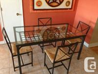 I am selling my Dining table with 4 chairs. Its 2 years