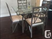 Cast iron glass table with 4 chairs Glass in excellent