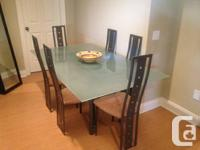Beautiful, modern and elegant glass and metal dining