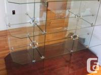 Store display. All shelves are glass and base is veneer