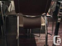 Glass rectangular table with metal detachable legs and