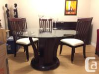"Gorgeous 54"" round, bevel edged glass top dining room"