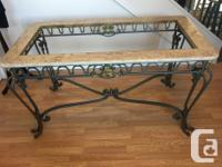 Gorgeous glass-top dinning room table with 6 chairs.