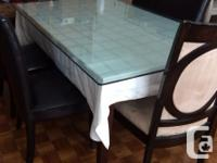 """Dimensions of the glass table top are 72"""" L x 42"""" W x"""