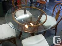 Glass top table with 4 chairs, very light weight
