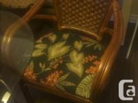 """42"""" glass top dining room table w/ 4 large arm chairs."""