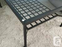 Glass top Ikea coffee table with dark brown metal
