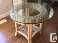 Pastel, wicker corner table, topped by tempered glass