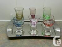 This is a collection of 6 liqueur glasses on a Trudeau