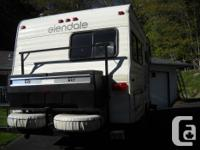 1981 Glendale 23' with large rear storage. Back
