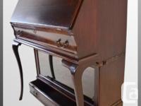 Original hardware; locks work on both desk and drawer,