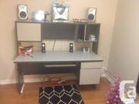 Black & grey computer workdesk with top hutch. $25.00.