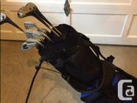 Like new golf bag with cover, can stand on its on or