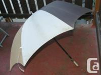 $5 - 1 Ball retriever. $2 - 1 umbrella with carrying