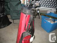 set of Mega Force golf clubs, bag and cart great