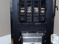 This Good Cheer Parlor Stove from the 1920's has lots