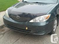 Make Toyota Model Camry Colour Green Trans Automatic